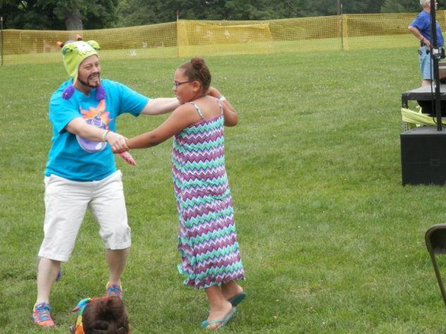 Izzy performing Happy with children